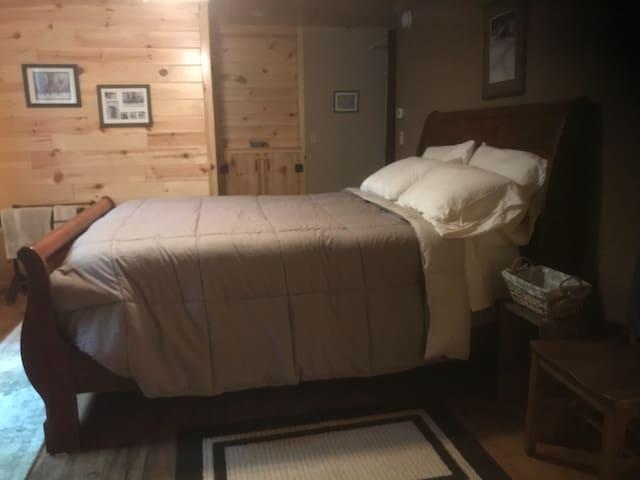 Sleigh style queen bed in bedroom