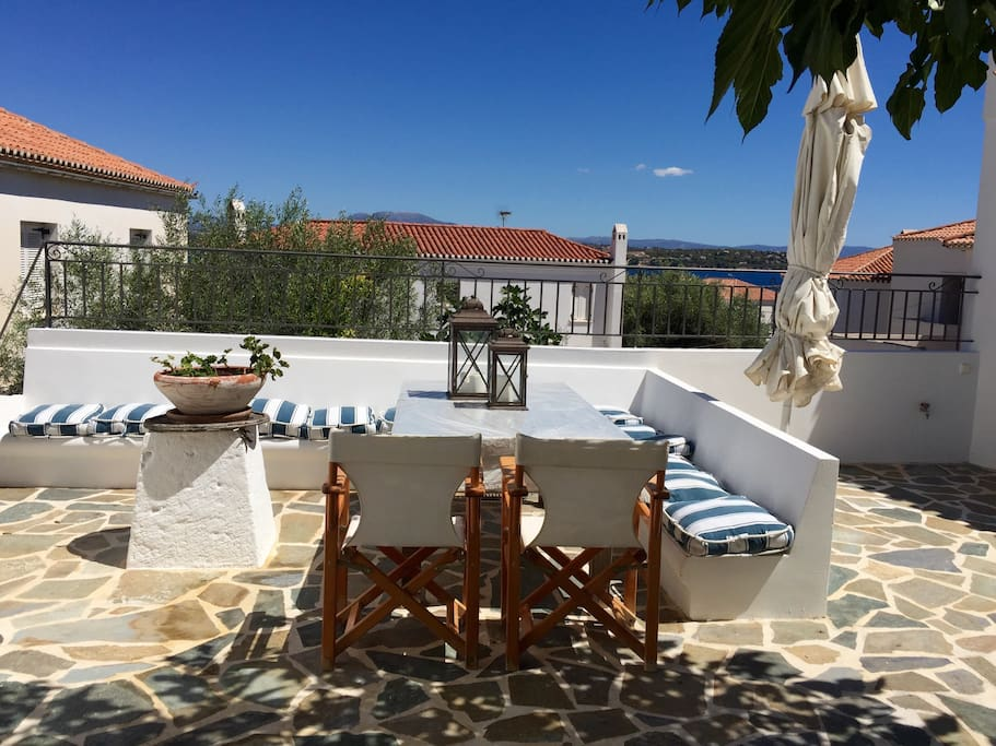 Shared courtyard and view to the sea