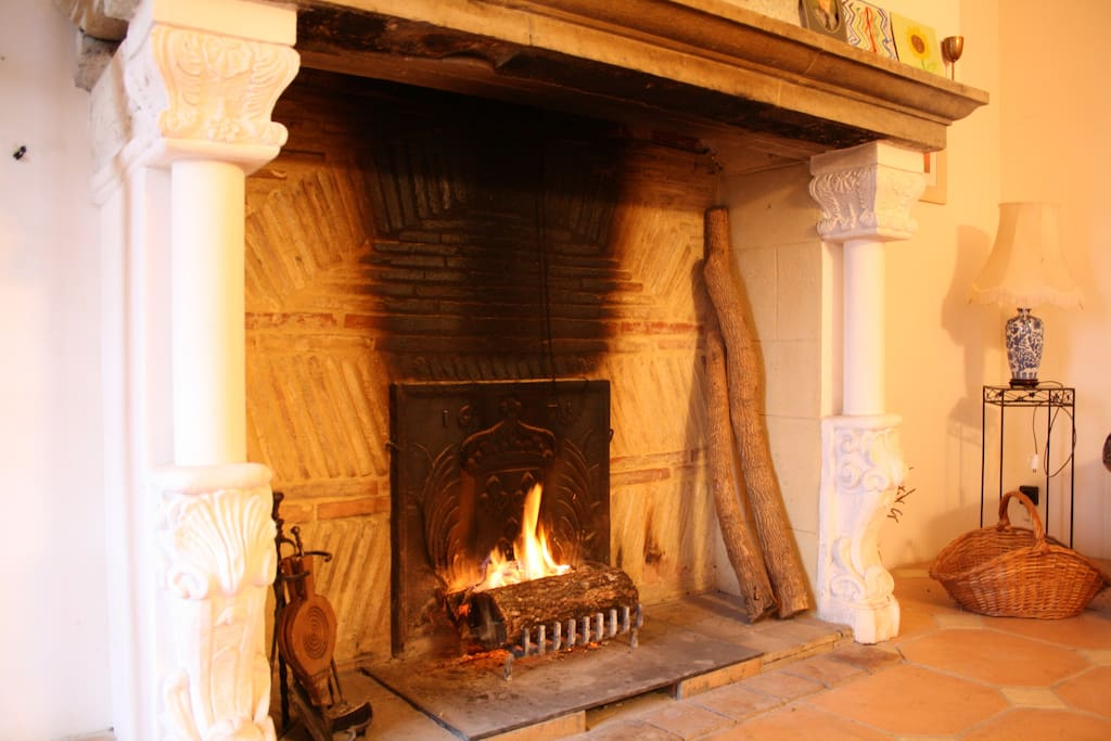 Fireplace in the main sitting room with ornate plasterwork.