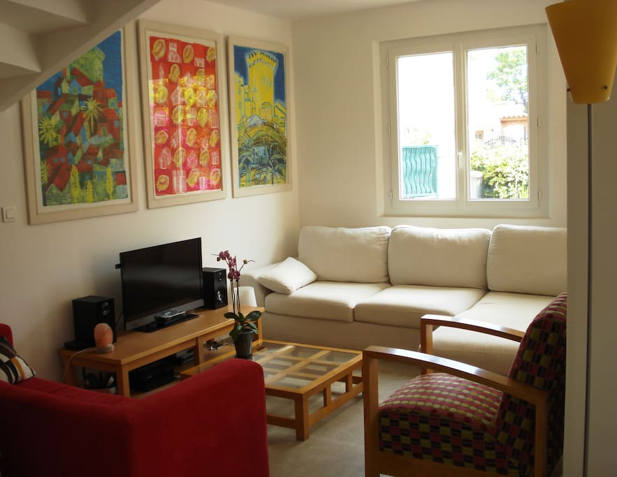 Living room with a very comfortable sofa which can be used as a single bed