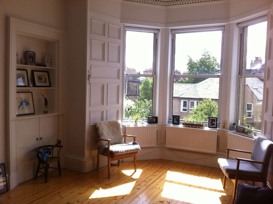 South facing sitting room to sunbathe, cosy up and day dream in. Find the secret television