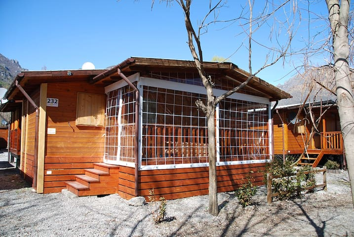 Chalet with veranda, nearby pool and Luganolake