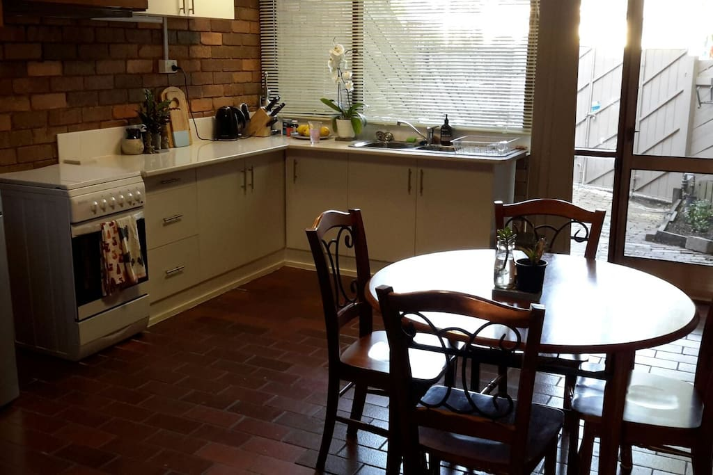 kitchen and meals area, cafe and tea offered for you to start your day and you are very welcome to cook your own meals.