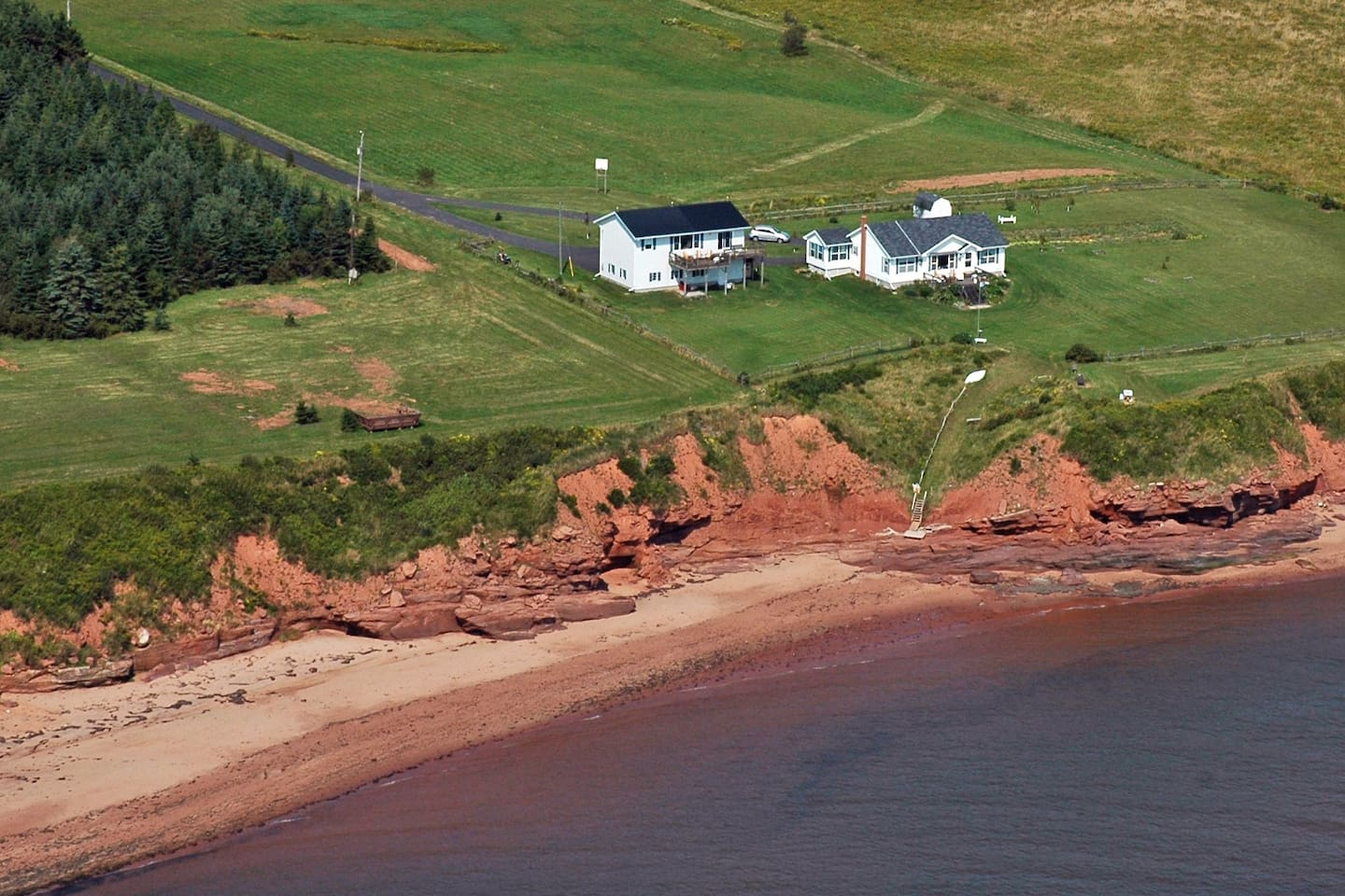 Kate's Cove Aerial View shows our beautiful sandy beach coves that you can access from the stairs at the edge of the property.