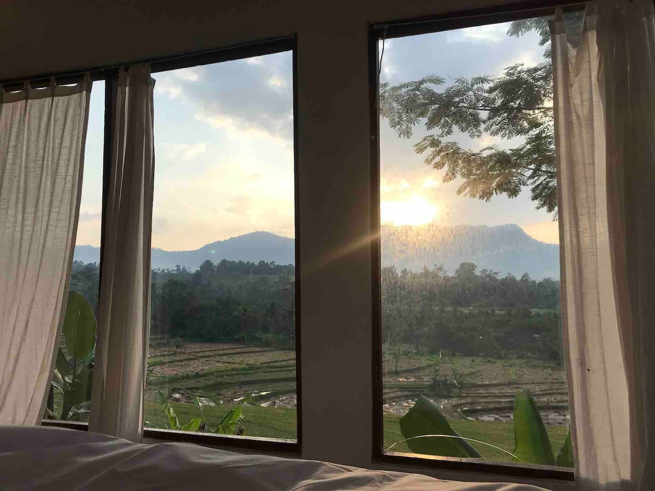 Real life view from the bed in room 3. All rooms are equipped with glass windows and have wonderful mountain views.