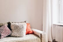 Salon z miejscem do spania. Living room with bed.