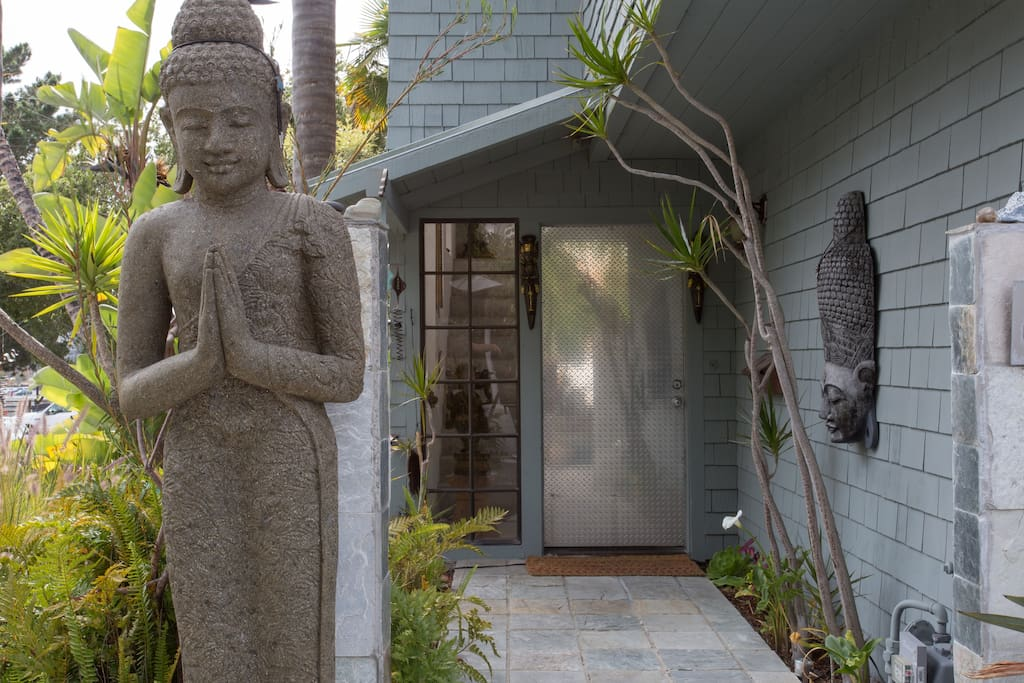 Owner's entrance. Welcome! The Indonesian statue, a birthday gift, is carved from one piece of volcanic rock.