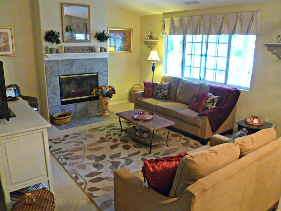 The family room is an inviting place to play games, watch TV or curl up by the fire with a good book!
