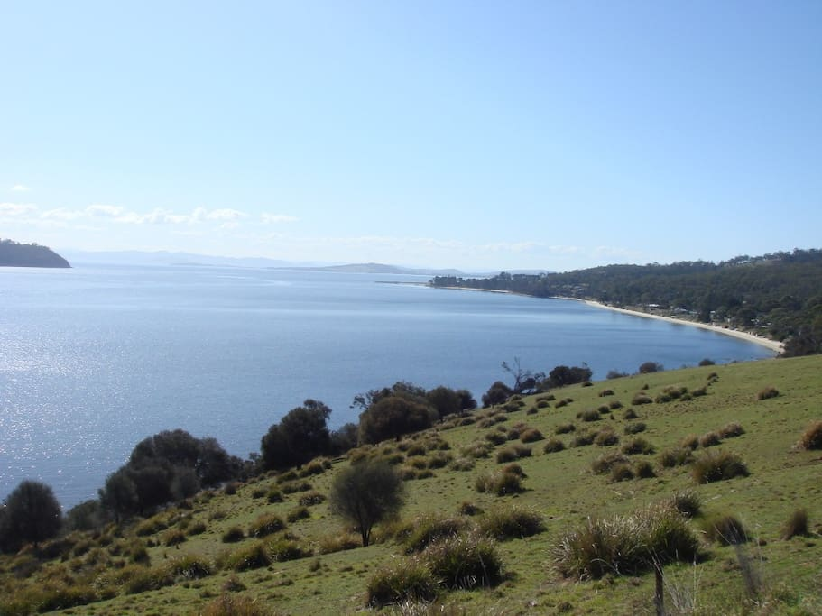 Looking north to the mouth of D'Entrecasteaux Channel and the River Derwent. In the right middle ground is Dennes Point, Nebraska Beach and Carrington Cottage.