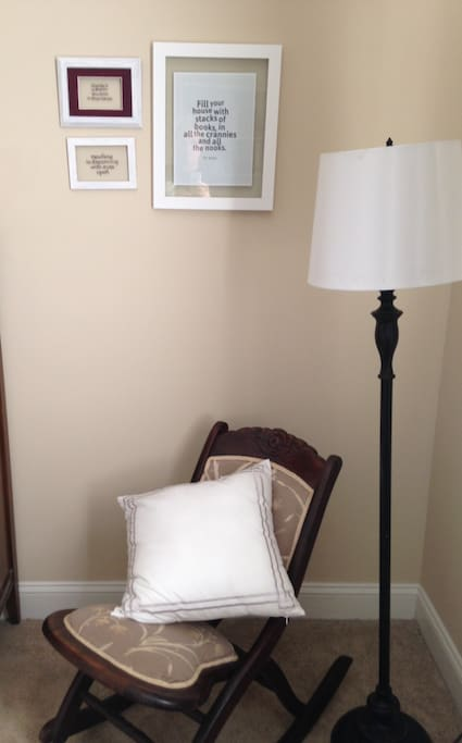 A corner reading nook welcomes avid and casual readers.