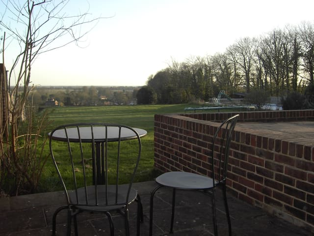 Patio with stunning view over Funtington to Bosham and West Wittering