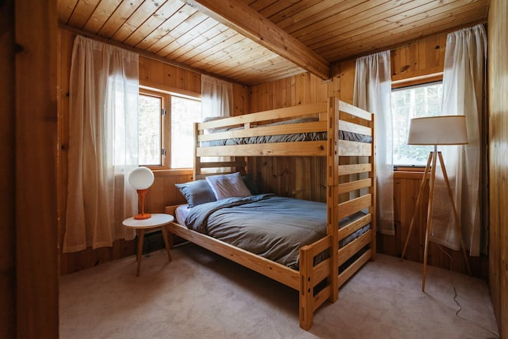 Bunk bedroom with full bed on bottom, twin on top