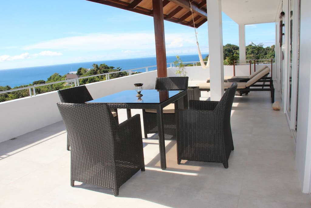 Comfortable covered terraced seating for dining alfresco