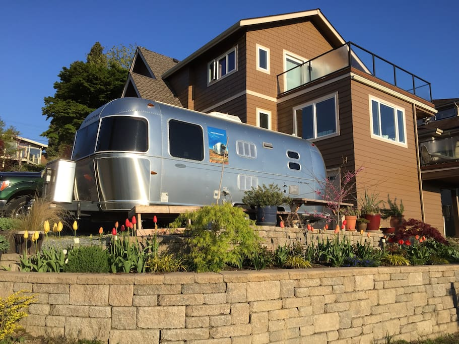 This is the back of the house and our Airstream, which is also available sporadically on Airbnb if you are an RV enthusiast to see what it's like living in an Airstream.