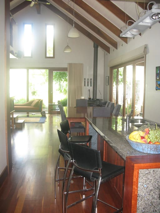 Huge open plan sitting/dining and kitchen room. Table for 8. Cathedral ceilings . Overlooking native garden and  BBQ area.