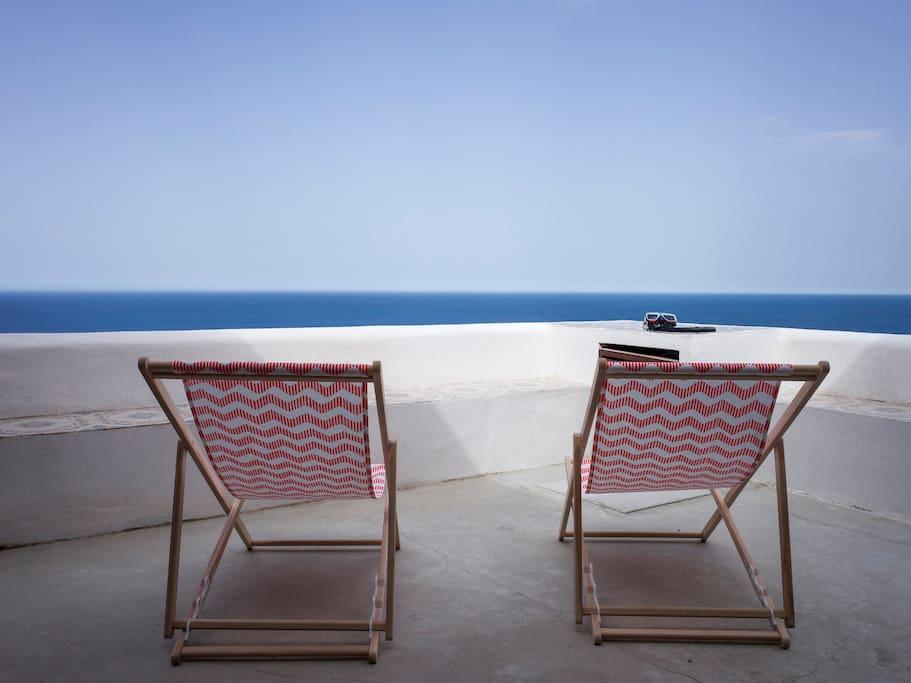Beach chairs and balcony view. Sdraie sul balcone.