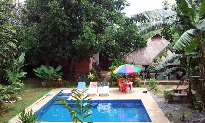 bambu hostel with a pool and garden