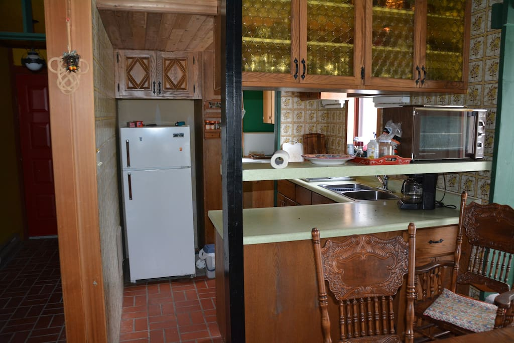 Looking from the dining area to the kitchen and pantry