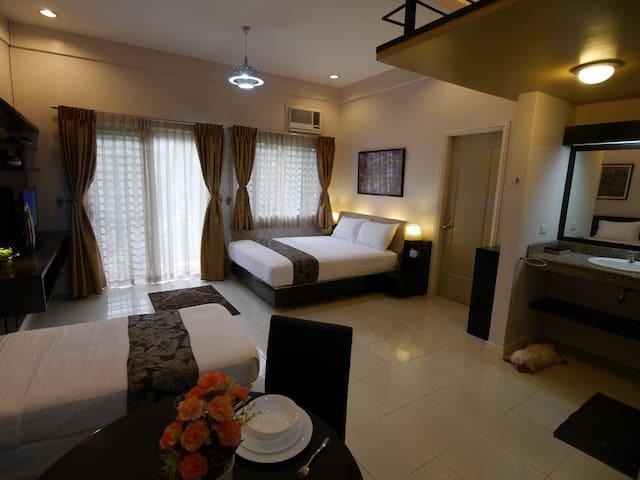 Dahlia at New Manila Suites - A Full Service BnB - Quezon City