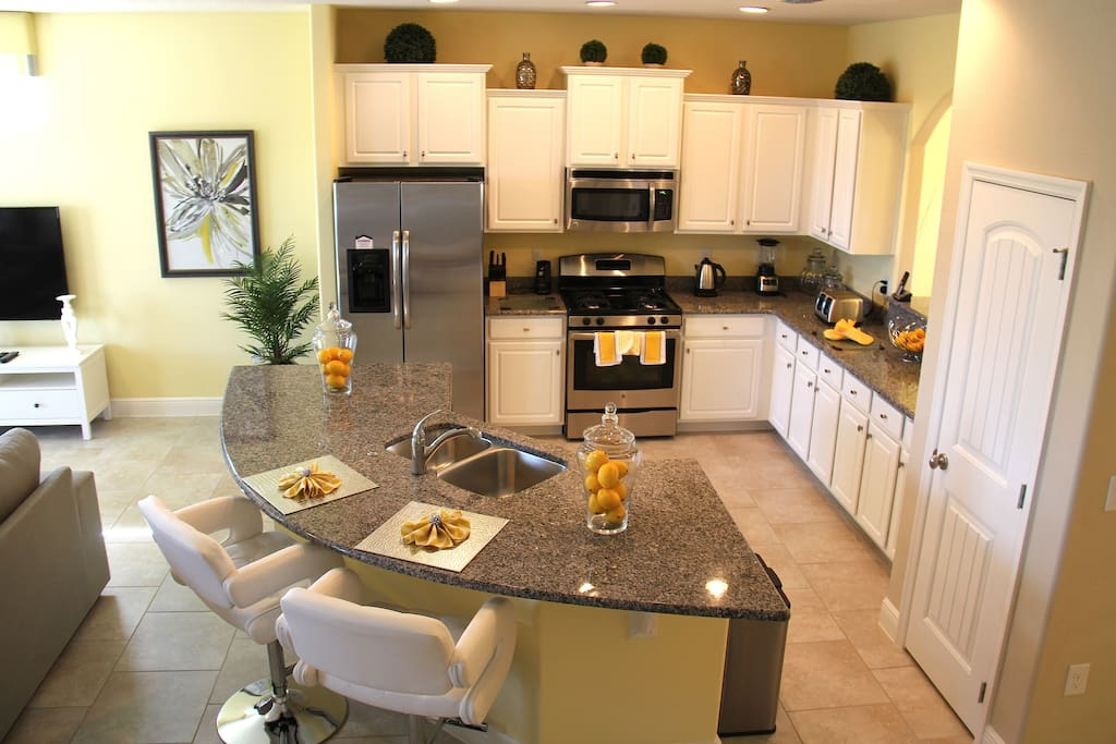 Large open plan kitchen, fully equipped with modern stainless steel appliances