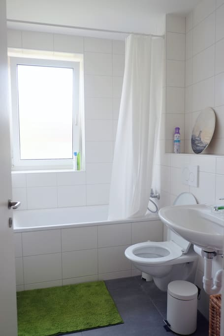 Bathroom with tub & window (privacy glass).