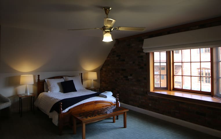 Main Bedroom with garden views, toilet / basin and reverse cycle air conditioning.