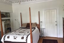 This is the bed with the entrance door to your right.