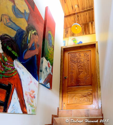 The hand carved door leading to your bedroom with lots of original art.