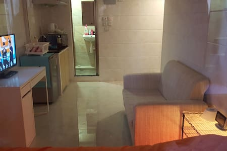 MY HOME is around 160 square feet.Clean, convenient, newlydecor Located just off Sai Yeung Choi South Street in central Mongkok. It's 3 minutes walk from Mongkok MTR station(E2 Exit).There are a variety of restaurants just below the apartment.