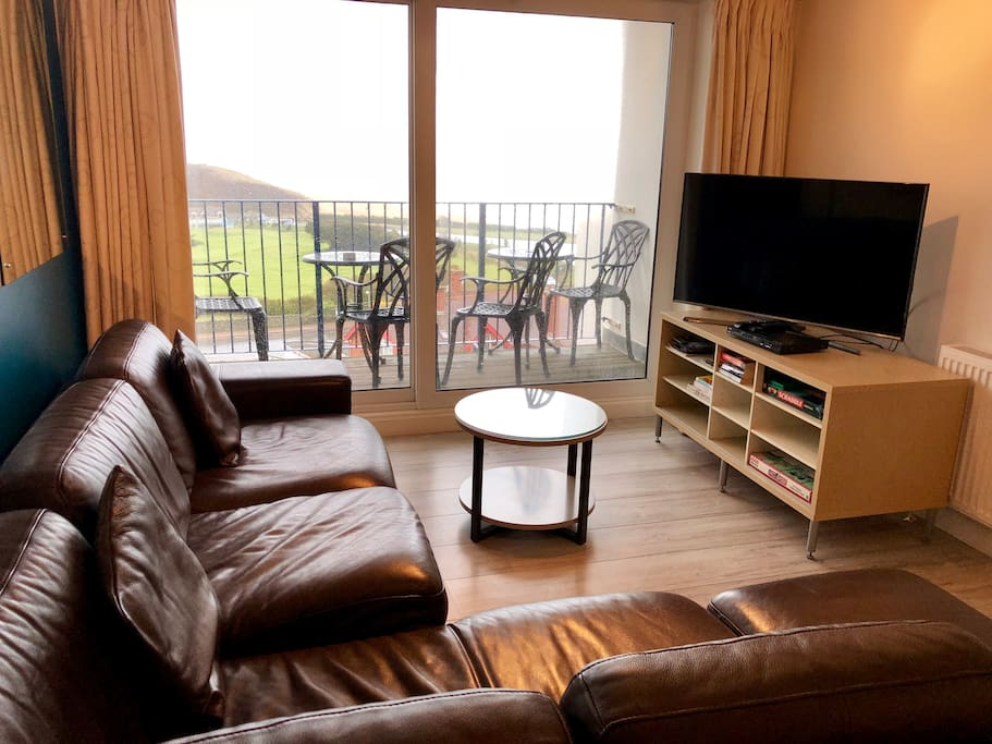 open plan living and Smart TV - again views to the beach