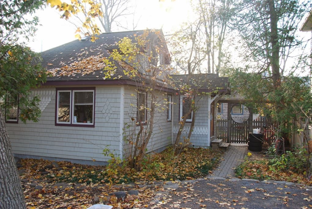 Cottage in the city exterior in autumn