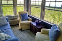 living room overlooking the water and the marsh