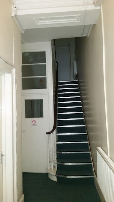 Building entrance. Bathroom and toilet up the stairs. Professionally cleaned weekly and always in perfect shape.
