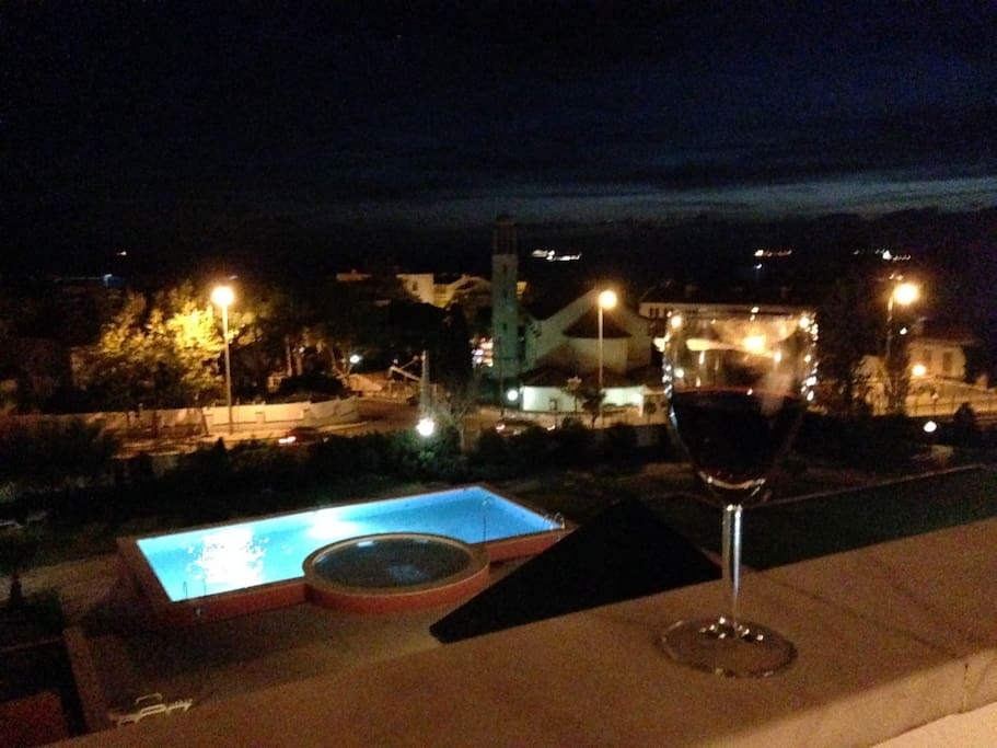 A glass of red on the balcony. The only thing better would be two glasses of red on the balcony!