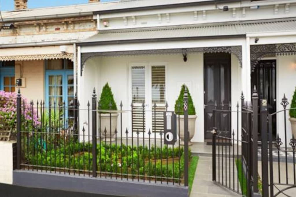 Victorian frontage with manicured gardens