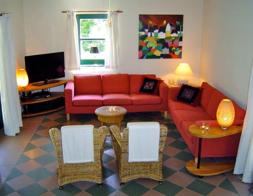 Cosy livingroom with (Dutch) TV set