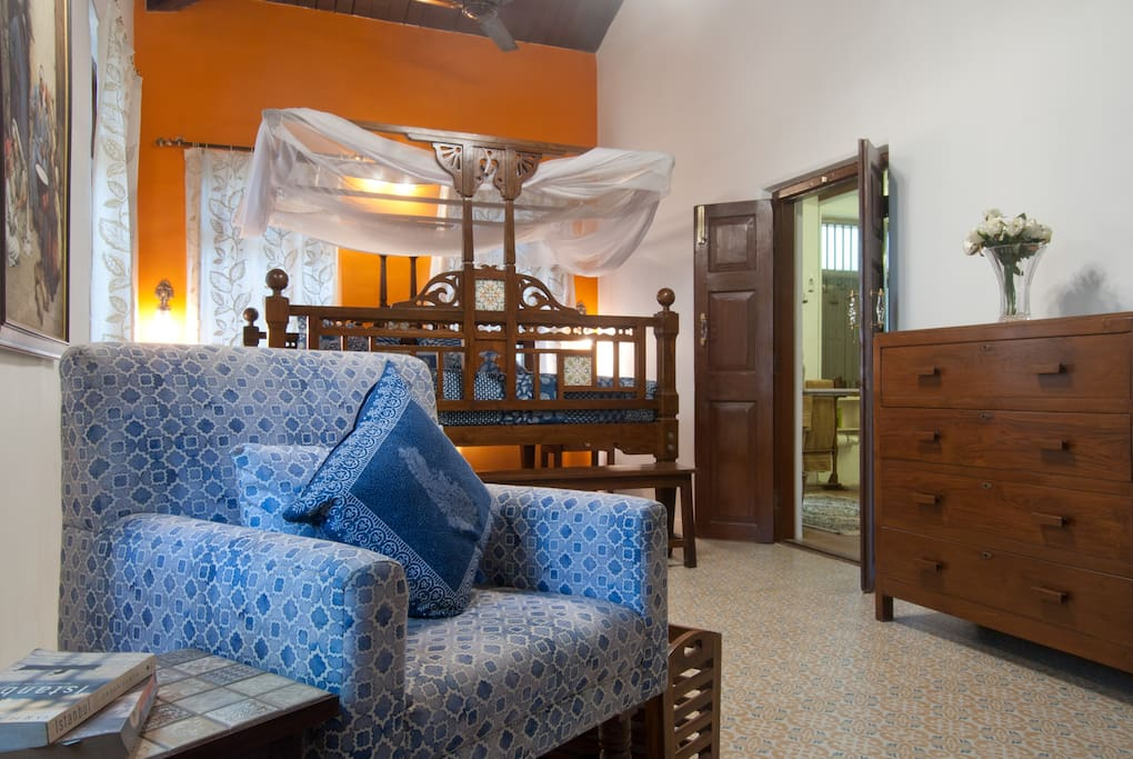 The orange and blue-themed bedroom is customised for the owner's daughter.