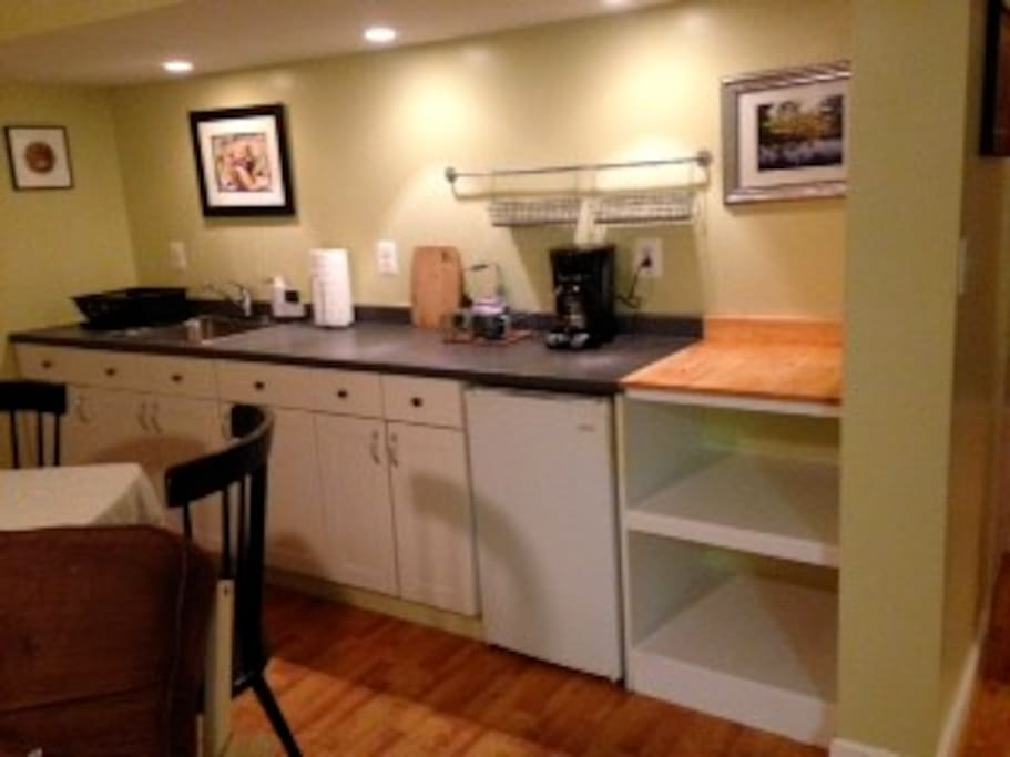 Kitchenette includes counter, sink and full size refrigerator. Note: Heating / cooking appliances are not allowed in the apartment due to zoning code regulations, however there is a microwave for our guests located in the laundry room just outside the apa