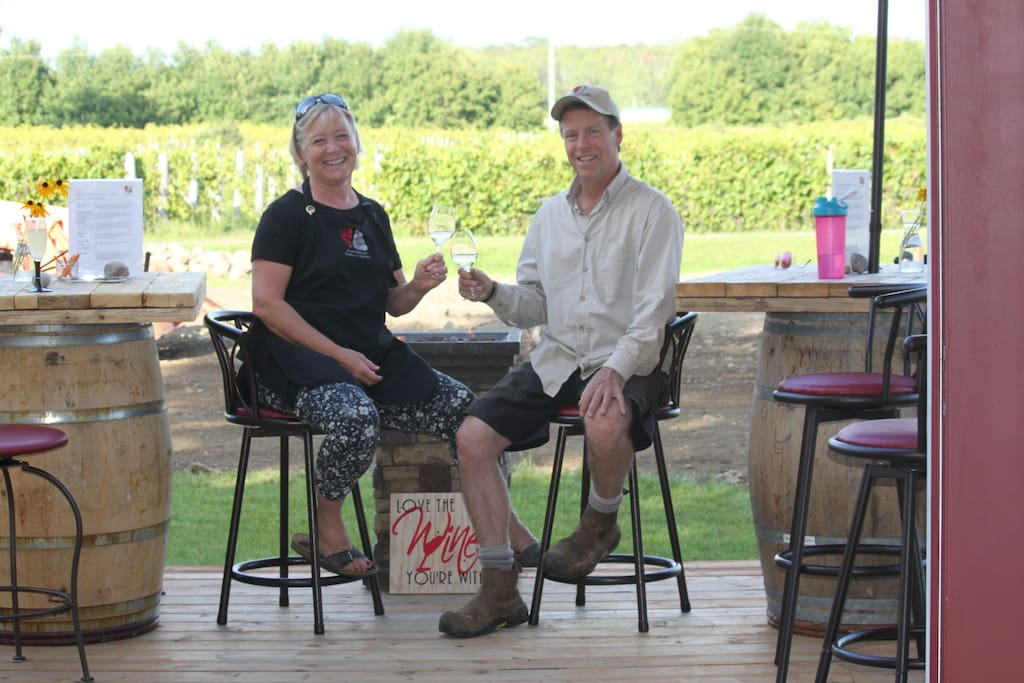 Your hosts relaxing on the patio overlooking the vineyard.  Norene and Marc