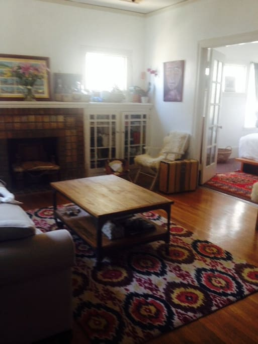 Living room with big comfy couch and big screen Smart TV w/ basic cable, Netflix, Amazon Prime, internet, etc.