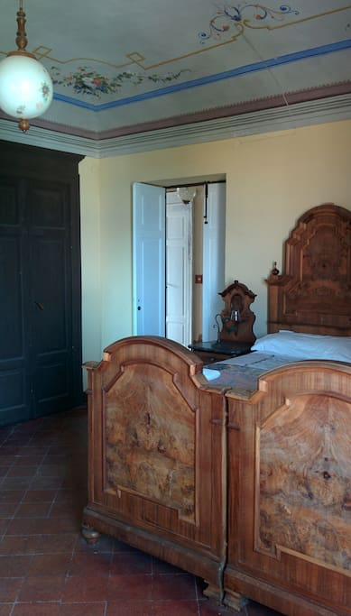 This is one of the bedrooms: double, with painted celing, big eonught to contain a 3rd bed.