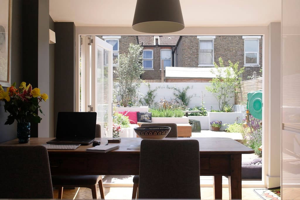 Open plan kitchen diner with a view of the garden.