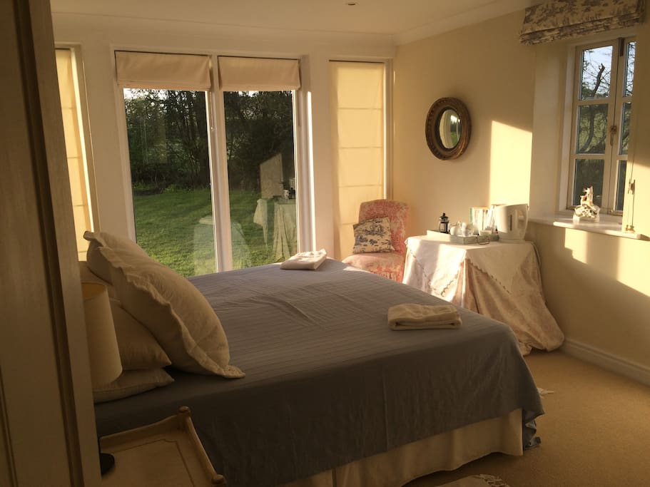 Very light and sunny room with double aspect over looking the garden.