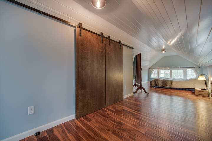 Barn door closet with shoe rack and velvet hangers for you to use