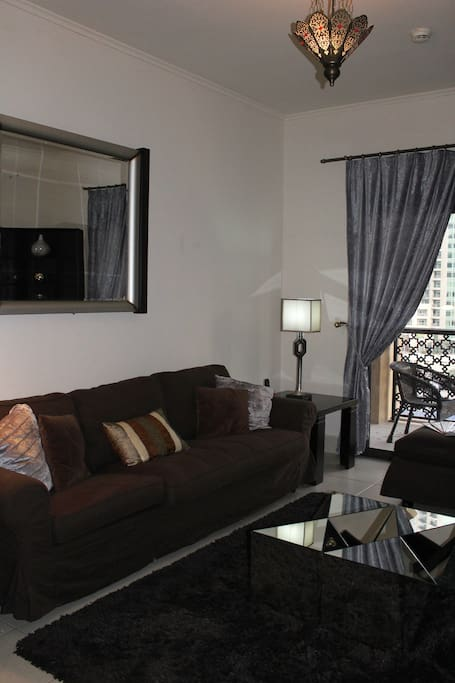 Living room with street view, balcony, smart TV, Wifi, cable TV