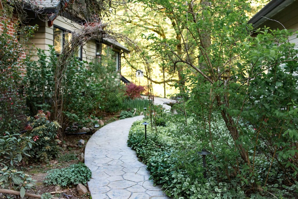 From the driveway, take the lush garden path leading to the back of the house to access the guest entrance. You are welcome to explore and utilize the yard.