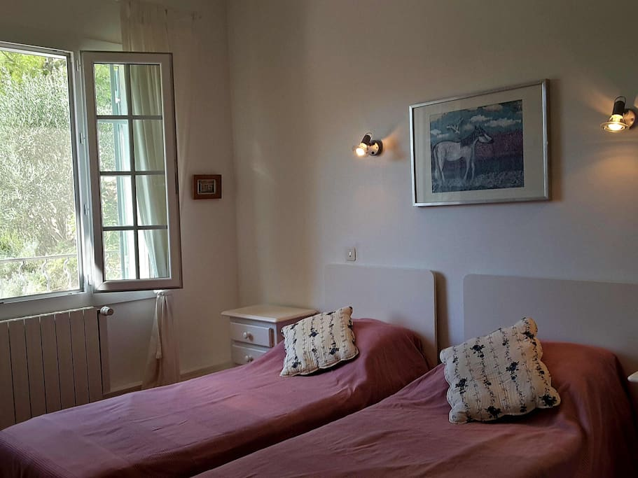The 2nd bedroom can be for a couple as a double bed or for two children as two single beds. It has river views from the windows