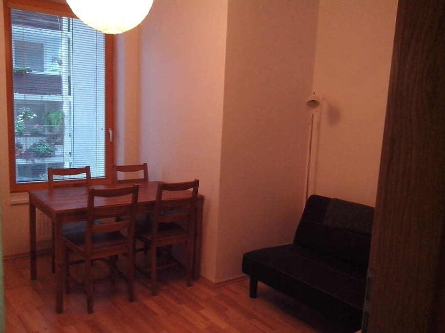 Dining Area includes 2nd futon, dining room table with 4 chairs, and privacy door.