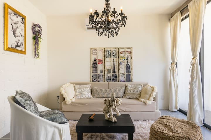 Welcome home!  We created this space with a very particular and eclectic style.   Enjoy doing some meditation in the living room with the jungle view or relax having a drink with friends!