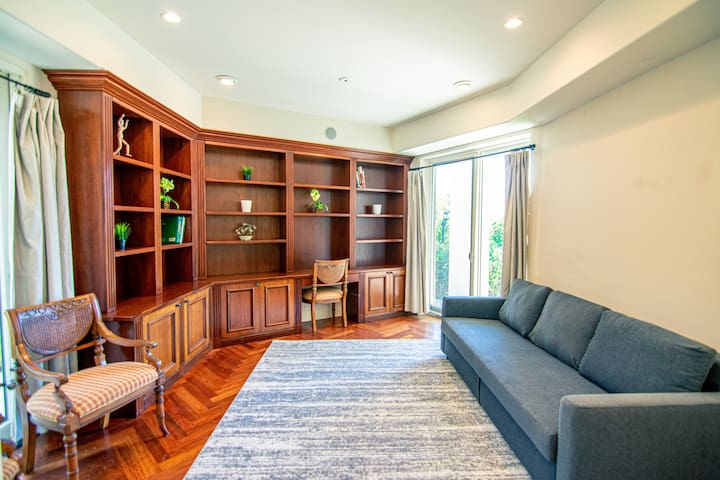 Library/office space includes couch that folds down to make it a 5th bedroom if needed.